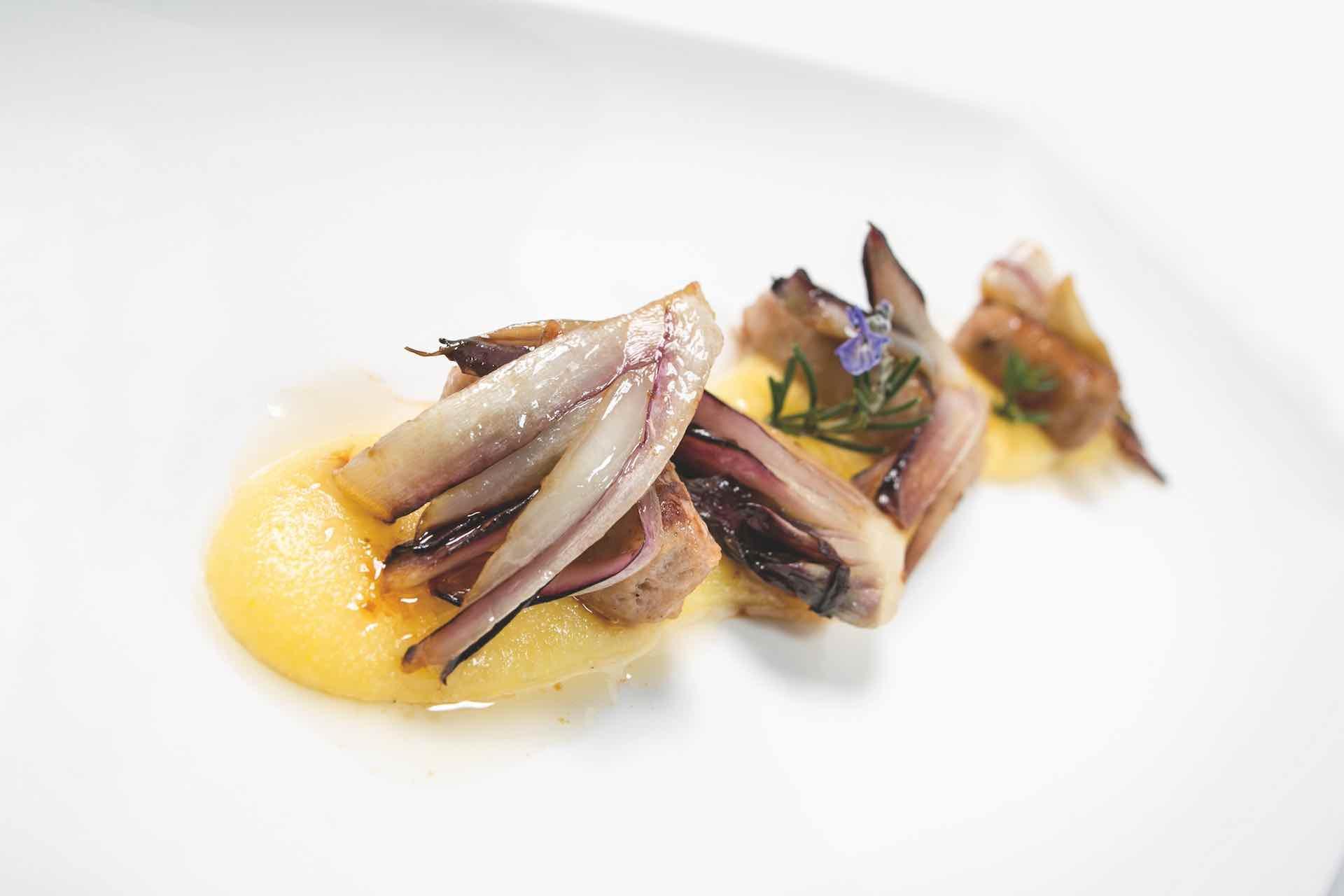 Polenta cremosa con salsicce - esperienza gastronomica in Veneto sulle Colline del Prosecco Valdobbiadene